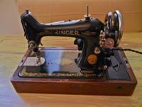 A 1909 Singer model B.U.7.-E sewing machine, with
