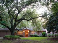 NESTED ON OVER 2.3 ACRES. THIS UPDATED STUNNING HOME