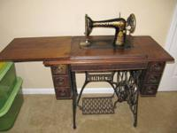 "THIS IS AN ANTIQUE ""RED-EYE 66"" TREADLE SEWING MACHINE"