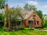 Beautifully maintained brick cape cod in the desirable
