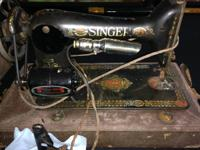 This in a vintage 1915 Singer stitching machine. I
