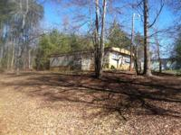 This mobile home park is 1.7 acres and includes 4