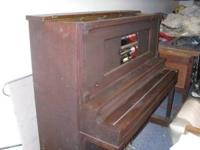 This is a 1916 Royal Cabinet Grand piano made by Krell