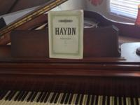 I have a beautiful antique baby grand piano that has