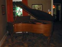 This gorgeous mahogany Starr Minum Grand Piano was