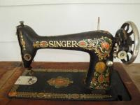 for sale is a 1922 SINGER 'Red Eye' very ORNATE treadle