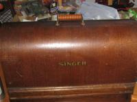 I have a 1922 Singer Sewing Machine in a bentwood case.