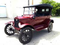 This is a 1924 Ford Model T Roadster,Open Tourer year