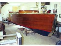Thoroughly restored antique timber watercraft - among