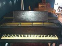 1926 baby grand piano, regularly tuned, a few