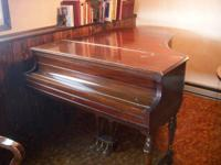 1928 baby grand piano 5-foot. Recently put in $1070.00