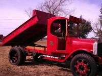 1928 MACK DUMP TRUCK .  This is a restored 1928 Mack