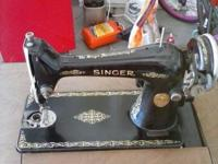 This is a Singer Sewing Machine from 1929 that folds