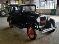 1929 FORD MODEL A. I INSTALLED NEW BATTERY IN IT, THE