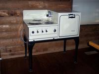 "THIS ANTIQUE FULLY RECONDITIONED RANGE STANDS 40"" tall"