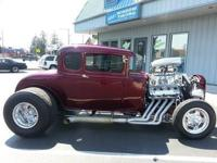 1930 Steel body 5-window Ford Coupe. Features: Paint