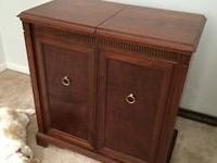 This converted radio cabinet is strong Walnut and is in