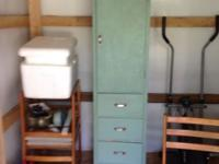 This is a tall single storage Hoosier type cupboard.