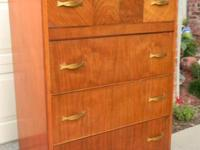 This stunning Art Deco 1930s waterfall chest of four