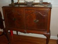 Small dining room buffet with arched legs. 2 door