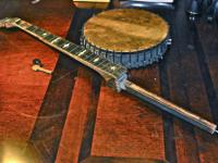 Vintage banjo drum, hooks and brackets for restoration.