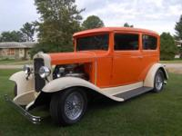 With its orange and cream color scheme, this Chevy