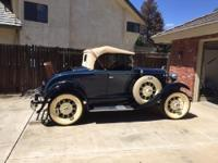 Blue with black fenders, Leather trunk, Rumble seat,