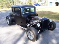 This a nice Collector Quality 5 Window Deuce Coupe. It