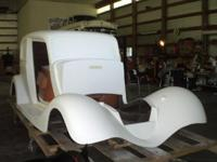 This fiberglass automobile is ready to shoot paint on.