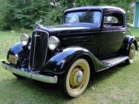 This low mileage black Chevy 3-window coupe is in good