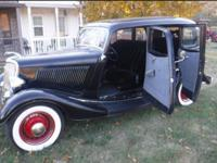 This is a beautiful 1934 Ford Deluxe, 4-door Bonnie and