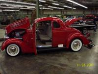 1935 ford five window coupe, viper red with gray tweed