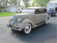 1936 Ford Deluxe Phaeton The color is Cordoba Tan, it