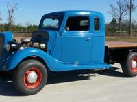 This truck is a 1936 Ford replica. It is a fiberglass