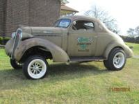THIS ONE BAD GASSER CAR. THIS IS A 1936 STUDEBAKER-ALL