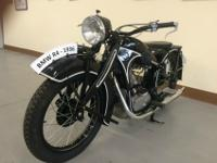 Beautifully restored 1936 BMW R4 motorcycle for sale.