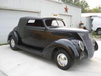 This car is titled as a 1937 Ford Convertible. 1937