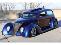 This custom sedan is styled after the 1937 Ford. Brand
