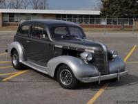 This 1937 Pontiac Deluxe Touring Sedan not only