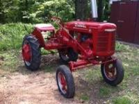 1939 McCormick Farmall A tractor. Newly painted . Call