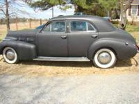 Available for sale is a 1940 Cadillac Touring Car with