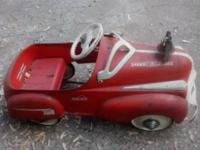 This is an all original, vintage child's pedal car ...