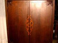 Gorgeous condition. The Armoire has drawers for storage