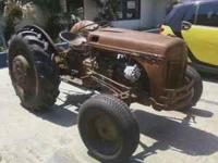 Ford Tractor 1940's 9N, rusty but runs good. Call  days