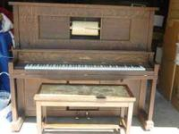 This player piano is made with Tiger Oak and has been