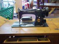 1940's Singer Sewing Machine with cabinet. All
