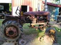 1941 Farmall A Tractor & Attachments as shown in photo.
