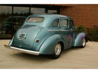 Here is a really sharp 1941 Willys Americar, 4-door
