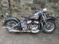 This is a 1942 Harley davidson model u. It has mostly