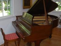 A lovely 1942 Steinway Baby Grand Piano in Walnut case.